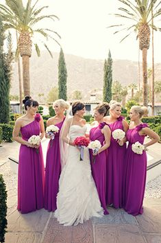 purple bridesmaid dresses. photo by hoffmannphotographer.com