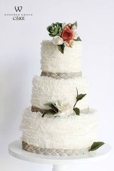 White frills and sugar flowers never go wrong.