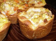 Cheesy Chicken Pot Biscuit Cups  Categories:Chicken, Quick & Easy  Serves:4-6  Prep Time:10 Min  Cook Time:15 Min  Ingredients    1 can(s)refrigerated biscuits ( i like grands)  1 cdiced cooked chicken breast  1 can(s)cream of chicken soup, fat-free  2/3 ccheddar cheese, shredded  1 tspparsley flakes  1/4 tspblack pepper