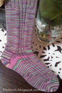 Marvelous Mock Cable Socks - Everyone loves fun and colorful socks and now you have a great way to make them with these Marvelous Mock Cable Socks. This free knitting pattern shows you how to make socks that are great homemade gifts and will keep your own feet nice and cozy. You'll love how detailed this pattern is and it is great for beginner knitters because it has a cabled look without you actually needing to cable. This will easily become one of your go to sock patterns this winter.