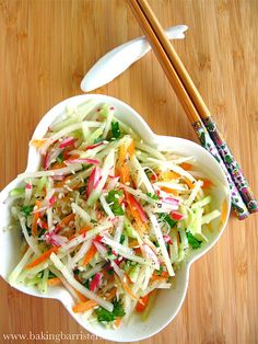 Sesame Lime Slaw  Makes 2 servings    1 cup julienned kohlrabi  1/3 cup julienned carrot  1/2 cup julienned cucumber  2 radishes, julienned  2 Tbsp. freshly chopped cilantro    2 tsp sesame oil  juice of 1 lime  1 tsp. freshly grated ginger    kosher salt  freshly ground pepper    sesame seeds