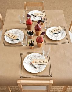 Brown craft paper to cover dinner table. Let the kids draw and decorate.