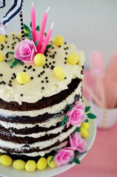 6 layer chocolate cake with whipped buttercream topped with lemon drops and black nonpareils