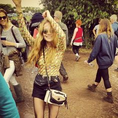 Meet Glastonbury's Most Stylish Revellers #refinery29 http://www.refinery29.com/glastonbury-street-style#slide3 Put your hands in the air for Clara Paget's double carry all options.