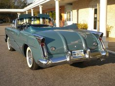 1954 Buick Skylark Convertible - I melted a pack of Crayons on the back boot of a car just like this my dad had just bought - thought he was going to cry! He took hours every weekend for a time trying to get it off then finally had the upholstery replaced!