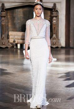 Brides.com: . Style BR-15-09, sleeveless sheath wedding dress with a plunging V-neckline and a hand beaded bolero, Inbal Dror (fall 2015)