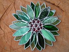 A little 3-d fun  Stained Glass Winter Flower. 65$, via Etsy.