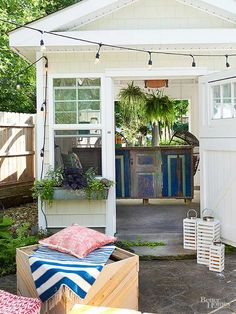 A DIY shed made by Jen and Raymond, a concrete contractor, shows off their resourcefulness. He found the walls in the dumpster at a job site. A neighbor installed a new shed door, and Jen garbage-picked the old one. The ceiling rafters are from a friend's deck -- they were replacing it and gave the couple all the wood. After spraying the inside with white paint, they created a bar with a concrete counter and wrapped it with old shutters and doors cut to size./