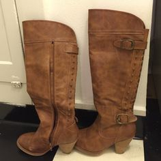 Boots Like new. Not quiet over the knee. Put free people for exposure. pretty sure they're leather but I can't say for sure because it doesn't say inside. I'm a size 7.5 and these fit me perfectly and I'm normally a 7.5 in all other brands of shoes. so they're really 8's but I'm putting 7.5. Free People Shoes Over the Knee Boots