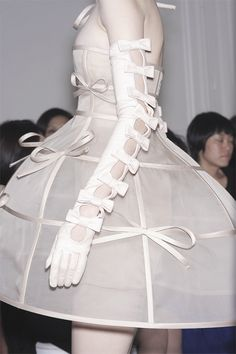 The structural and bondage-esque elements are perfectly offset by the jaunty little bows. Valentino.