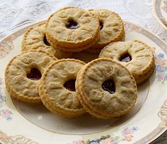 A Jammie Dodger consists of two pale-coloured, crisp, shortcake biscuits, with a layer of raspberry-flavoured jam between them. There is a heart-shaped hole cut out in centre of top biscuit so that you can see the jam inside, and a design imprinted on the biscuit around this hole.