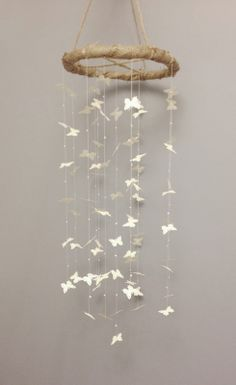 Shabby chic, rustic butterfly mobile.  Pearl beads between each butterfly, roughly 3 feet long.  Secured with twine.