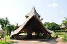 TOP 10 bamboo designs of 2013 the 'panyaden school' is located in the lush forests of chiang mai in northern thailand. it educates its multicultural students through a fusion of buddhist principles and ecological sensitivity. designed by dutch practice 24H architecture, the campus seems to be built under a group of enormous fallen leaves, made of natural locally sourced materials and labor that create an all around sustainable and comfortable low-impact facility.