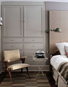 I am addicted to creative storage solutions. The nailhead headboard is also amazing