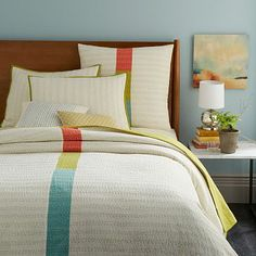 I love the feel of this quilt, the simple line of color down the center.  Kantha Coverlet + Shams - Ivory from West Elm