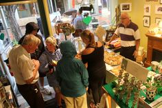 People sampling food from DeLitefull CrEATionS at Lennon's Irish Shop on Jay Street for the Merchant Mash Up! in downtown Schenectady on Friday, August 17, 2012.