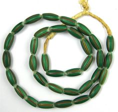 Old RARE Green Striped Melon Shape Venetian Glass African Trade Beads 19 Inches   THIS IS A NICE STRAND OF OLD AND RARE STRIPED MELON SHAPE VENETIAN GLASS AFRICAN TRADE BEADS. The colors are green with white, yellow, and red stripes with a white color core center. This is a rare beautiful color combination for this style of beads. #tradebeads