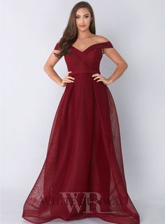 Prima Dress By Jadore  A beautiful full length gown by Jadore. An off shoulder style featuring a fitted bodice and flared skirt.