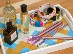 Keep perfume, makeup and jewelry stylishly displayed with this custom tray. Paint wooden chips in the palette of your choice, then place them in a herringbone pattern on the base of your tray.