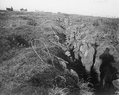 Engineers of the 4th Candian Division waiting in an abandoned trench to go forward during the Hundred Days Offensive.