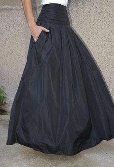 Long and flowing Taffeta skirt. Classical look. Comfortable and adds touch of elegance. Could match with fitted tops or oversized ones. Made to measure. Available in different lengths according to your wishes :) MATERIALS - high quality taffeta CARE INSTRUCTIONS -Dry clean -Hand wash