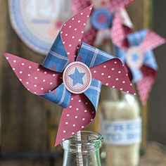 Make these adorable paper pinwheels for your Fourth of July celebration. Use the printable templates for this patriotic look and follow the step-by-step tutorial for an old school look.