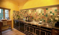 French Kitchen - Love the tile gallery. Very unique.