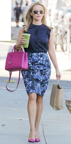 Even a coffee run (or, a green juice run, in this case) is an opportunity for Reese Witherspoon to piece together another on-point outfit. She styled her navy Draper James blouse with a blue floral-print pencil skirt and added pops of fuchsia by way of her top-handle purse and pumps.