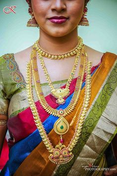 Variation in lengths of gold necklaces is commonly seen in South Indian brides.