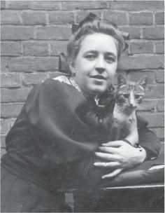 A young Corrie ten Boom with her cats.
