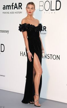 Lady in black: Karlie wowed on the red carpet in an off-the-shoulder Marchesa gown with th...