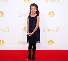 """Aubrey Anderson-Emmons might be little, but she certainly brings some big laughs on the hit television show """"Modern Family."""" The actress looked adorable as she flashed a big smile in a dark blue lace dress.too cute"""