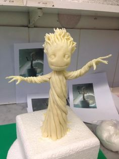 "How to create the baby dancing groot cake. Fondant sculp, then paint the ""wood""."