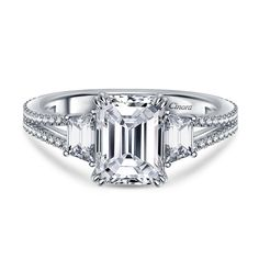 I LOVE this one. My only concern is how a wedding band would pair with it. Emerald Cut Diamond Three Stone Engagement Ring with Cathedral Split Shank in Platinum