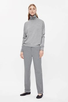 Roll-neck with elongated sleeves
