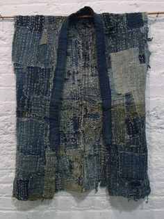 Old Boro Noragi, a Japanese work jacket with no sleeves. Indigo dyed, mended countless times with hand stitching. Cloth from 19th century.