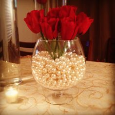 Ivory Pearls and Red Roses or Cala Lillysin a oversize champagne vase. A classy centerpiece for you, friends and family members wedding reception or special event. Wedding Table Centerpieces, Flower Centerpieces, Wedding Favors, Wedding Reception, Wedding Decorations, Wedding Ideas, Red Wedding, Wedding Flowers, Wedding Motifs