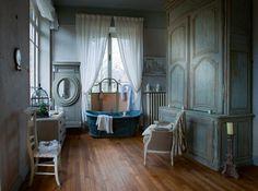 Love the armoire in the bathroom; the screen behind the bathtub; ivory linen; beautiful chair in the bathroom!  au revoir Noël - Sharon Santoni