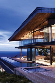 Современные дизайн проекты загородных и частных домов в стиле хай-тек. Интересные дизайнерские решения для фасадов домов hi-tech с плоской крышей на фото.