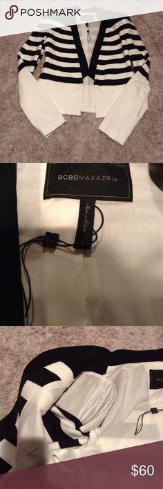 BCBG MAXAZRIA blazer! Beautiful black and blazer!  NWOT never worn or washed! Some shoulder padding for extra definition! BCBG Jackets & Coats Blazers