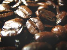 Macro shot of coffee beans, showing off the sheen, shape, and texture.    Title: Coffee Beans  Sizes: 5x7 and 8x10    Details: Printed on