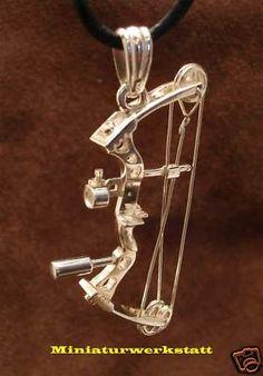 Compound bow pendant