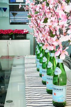 Modern Spring Home Tour! This modern and graphic home gets a pretty in pink update with simple, inexpensive tips for spring and summer decorating - like these San Pellegrino bottles used as vases.