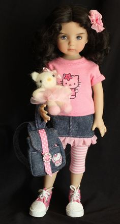 """""""Hello Kitty"""" Outfit for Dianna Effner's Little Darling Dolls and like OMG! get some yourself some pawtastic adorable cat shirts, cat socks, and other cat apparel by tapping the pin! Sewing Doll Clothes, American Doll Clothes, Baby Doll Clothes, Sewing Dolls, Doll Clothes Patterns, Hello Kitty Outfit, Hello Kitty Clothes, Pretty Dolls, Cute Dolls"""