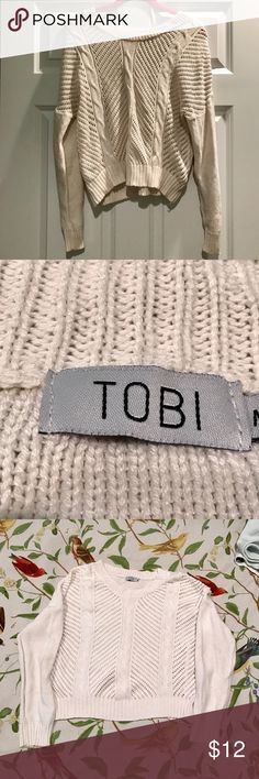 Tobi White Knit Cropped Sweater White knit cropped sweater from topi. The front knitting is partly transparent. Has been worn so it is in okay condition. Looks great with high-waisted leggings or jeans! Tobi Sweaters Crew & Scoop Necks