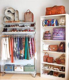 Wardrobe racks and shelves of shoes.