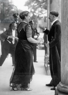 Adolf Hitler in tails in front of the Festspielhaus in Bayreuth, with Winifred Wagner, the director of the Richard Wagner Festival, In the background left Hitler's personal photographer Heinrich Hoffmann at work. World History, World War Ii, Greek History, Indira Ghandi, Germany Ww2, The Third Reich, Sigmund Freud, Wwii, Photos