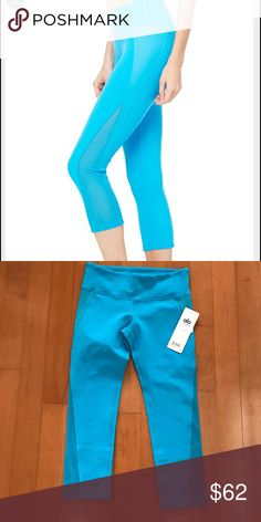 Alo Yoga Nova Capri mesh side, seaport blue NWT The Nova Capri is a slightly longer Capri with on trend fabric blocking that combines power mesh and glossy texture with stretch fabrication. Moisture wicking and movement inducing ALO Yoga Pants Leggings