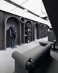 Viktor and Rolf 's first flagship store covered in grey felt by Architecture et Associés