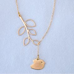 Golden bird on branch by StarfishStoryGifts on Etsy, $18.00